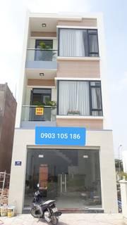 Bán nhà mới xây 1 trệt 2 lầu mặt tiền đường DT743A, Bình An, Dĩ An, Bình Dương
