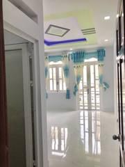 Nhà đẹp 1 trệt 2 lầu BTCT đón lộc sau nhà thờ Tân Hương 3x7m giá 2,35 tỷ