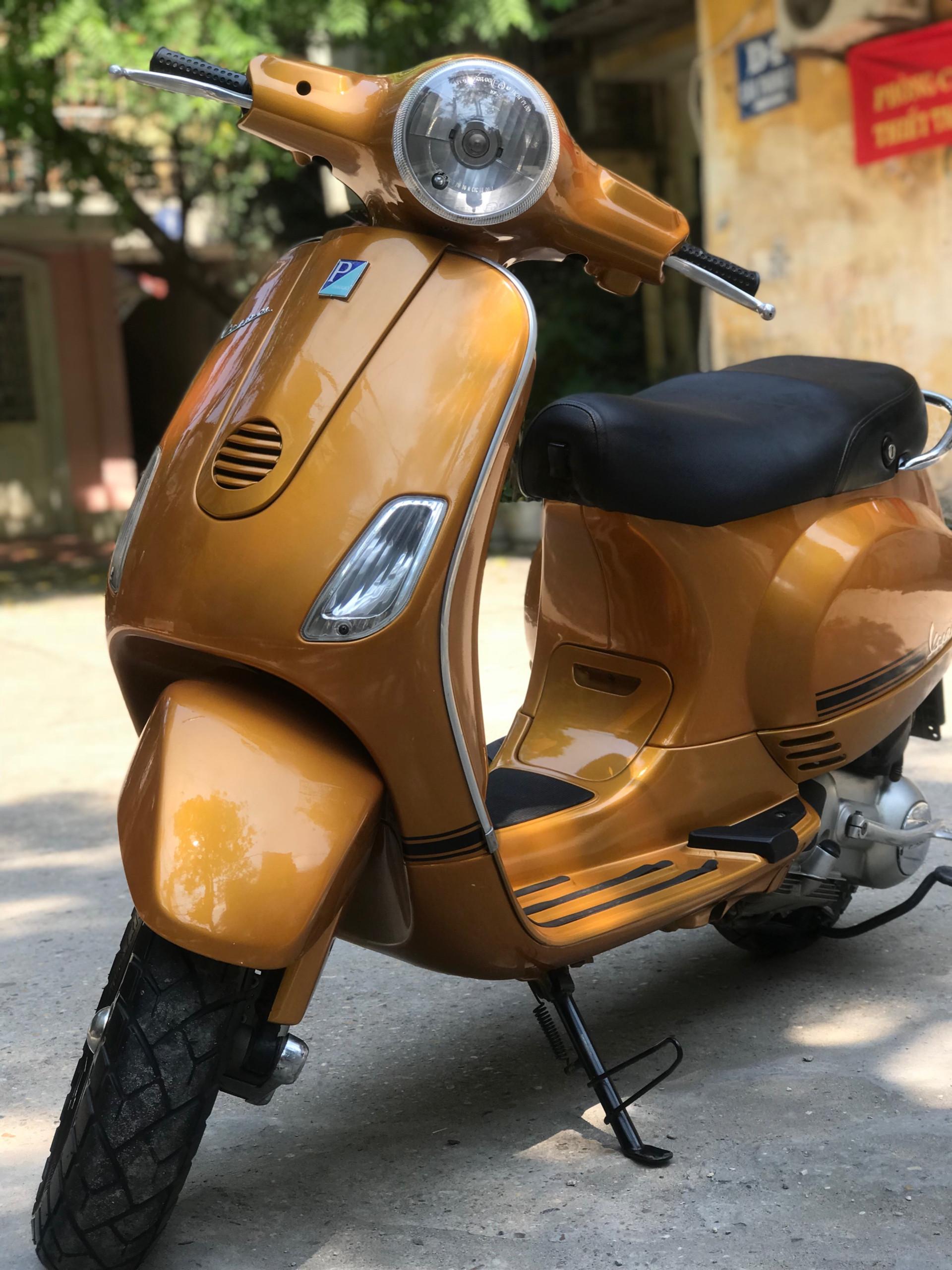 Cần bán Vespa LX 125 nhập khẩu đời chót màu vàng Ero3